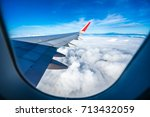 the plane on the clouds | Shutterstock . vector #713432059