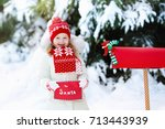 Happy Child In Knitted Reindee...