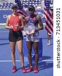 Small photo of New York, NY USA - September 10, 2017: Amanda Anisimova & Cori Gauffof USA hold respective trophy junior girls final of USA at US Open Championships at Billie Jean King National Tennis Center