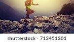 woman trail runner running on... | Shutterstock . vector #713451301