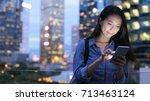 asian woman send text message...   Shutterstock . vector #713463124
