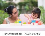 asian mother and daughter are... | Shutterstock . vector #713464759