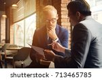 pensive business people... | Shutterstock . vector #713465785