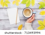 woman hand holding cup of... | Shutterstock . vector #713493994