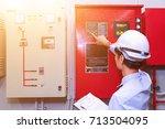 engineer test fire extinguisher ... | Shutterstock . vector #713504095