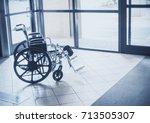 solitary wheelchair resting in...   Shutterstock . vector #713505307