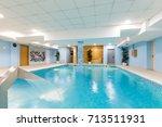 indoor swimming pool in hotel... | Shutterstock . vector #713511931