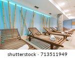sunbeds in hotel swimming pool | Shutterstock . vector #713511949