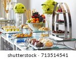 fruits and sweets dessert on a...   Shutterstock . vector #713514541