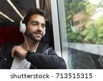 guy listening to headphones on... | Shutterstock . vector #713515315