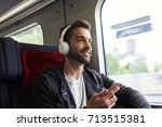 dude on the move on train with... | Shutterstock . vector #713515381