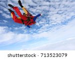 Small photo of Tandem skydiving. Tandem is flying in the sky.