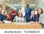 female boss addressing office... | Shutterstock . vector #713560615