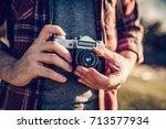 handsome man is exploring new... | Shutterstock . vector #713577934