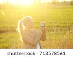 a young woman in the green... | Shutterstock . vector #713578561