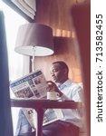 man reading morning newspaper... | Shutterstock . vector #713582455