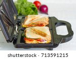 sandwich toaster with toast and ... | Shutterstock . vector #713591215