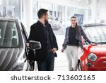 couple chooses the new car in... | Shutterstock . vector #713602165