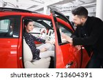 couple chooses the new car in... | Shutterstock . vector #713604391
