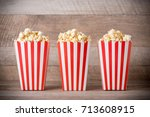 popcorn in red and white... | Shutterstock . vector #713608915