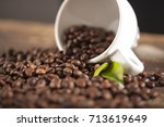 white cup of coffee beans  macro | Shutterstock . vector #713619649