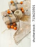 christmas gifts on the table | Shutterstock . vector #713623501