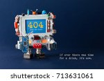 Small photo of Error 404 page template website. Handyman robot computer, colorful capacitors, circuit light bulb in hands. Warning message on screen text If ever there was time for a drink it is now. Blue background