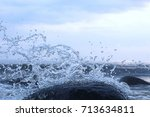 splashes from the waves bumping ... | Shutterstock . vector #713634811