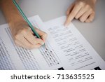 close up of hands of student... | Shutterstock . vector #713635525