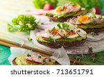 open sandwiches with avocado... | Shutterstock . vector #713651791
