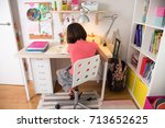school girl doing homework at... | Shutterstock . vector #713652625