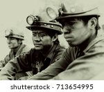 Small photo of Vietnam, Halon Bay - 15-05-2009: three coal miners with hard hats black and white.