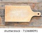 empty vintage cutting board on... | Shutterstock . vector #713688091
