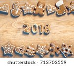 christmas cookies on wooden... | Shutterstock . vector #713703559