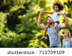 portrait of young father... | Shutterstock . vector #713709109