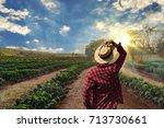 farmer working on coffee field... | Shutterstock . vector #713730661