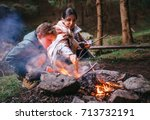 mother with son make campfire | Shutterstock . vector #713732191