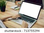 women using a laptop on white...   Shutterstock . vector #713755294