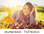 beautiful young woman smiling... | Shutterstock . vector #713762611