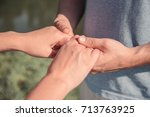 man and woman holding each... | Shutterstock . vector #713763925