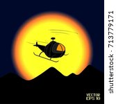 black silhouette of helicopter...   Shutterstock .eps vector #713779171