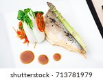 bream fish with asparagus ... | Shutterstock . vector #713781979