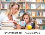 school kids team work in school | Shutterstock . vector #713783911