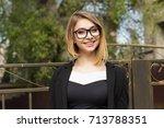 woman outdoors. half length... | Shutterstock . vector #713788351