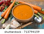 spicy carrot soup with harissa... | Shutterstock . vector #713794159
