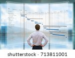 project manager looking at ar... | Shutterstock . vector #713811001