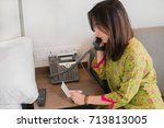 female woman is using telephone ... | Shutterstock . vector #713813005