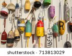 colorful lobster buoys on the... | Shutterstock . vector #713813029