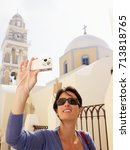 woman taking pictures | Shutterstock . vector #713818765