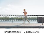 side view of slender senior... | Shutterstock . vector #713828641